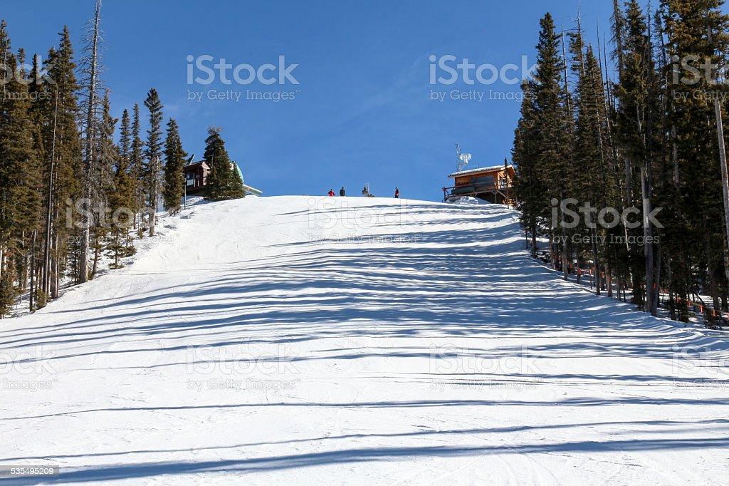 Ski run with people on top at Purgatory stock photo