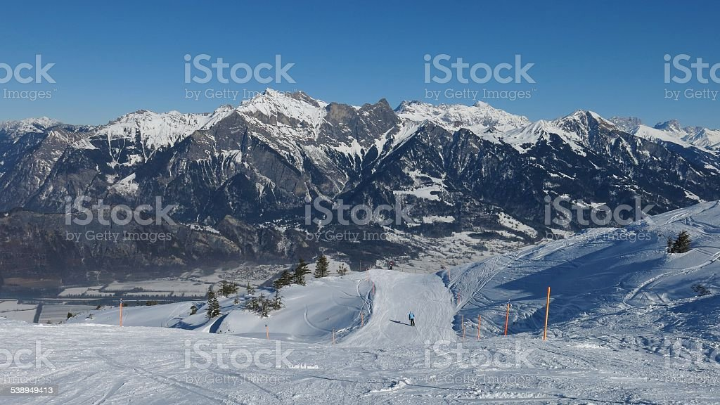 Ski slope and high mountains stock photo