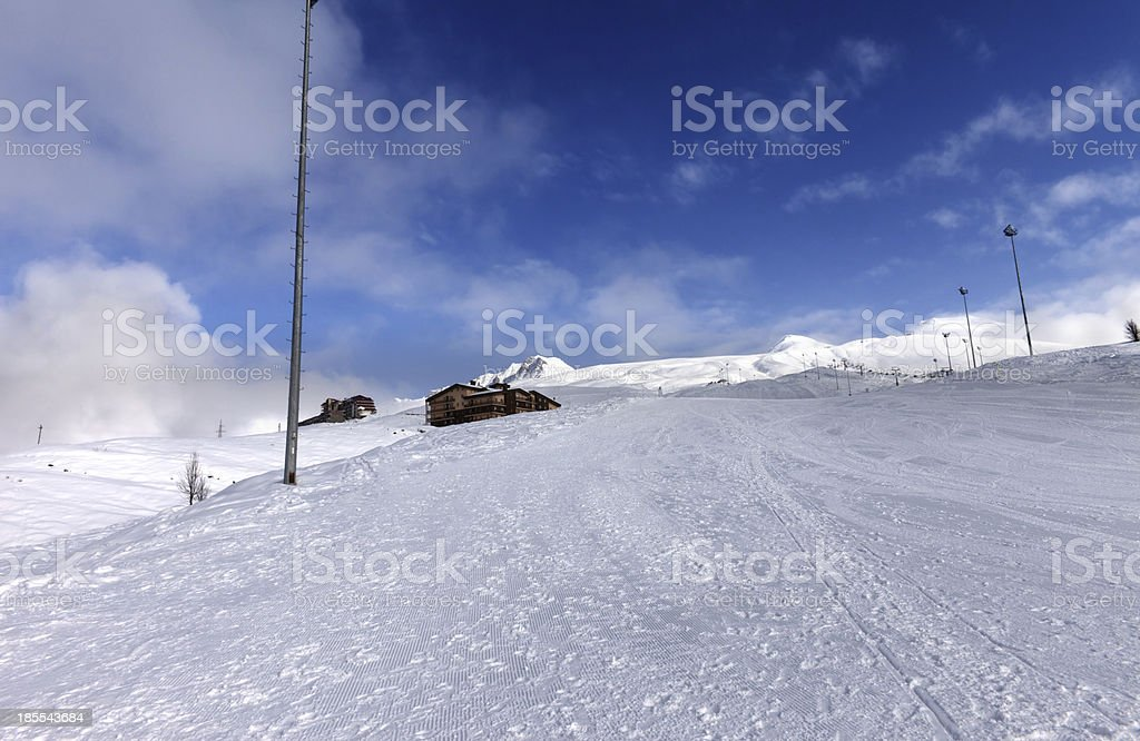 Ski slope and hotels in winter mountains royalty-free stock photo