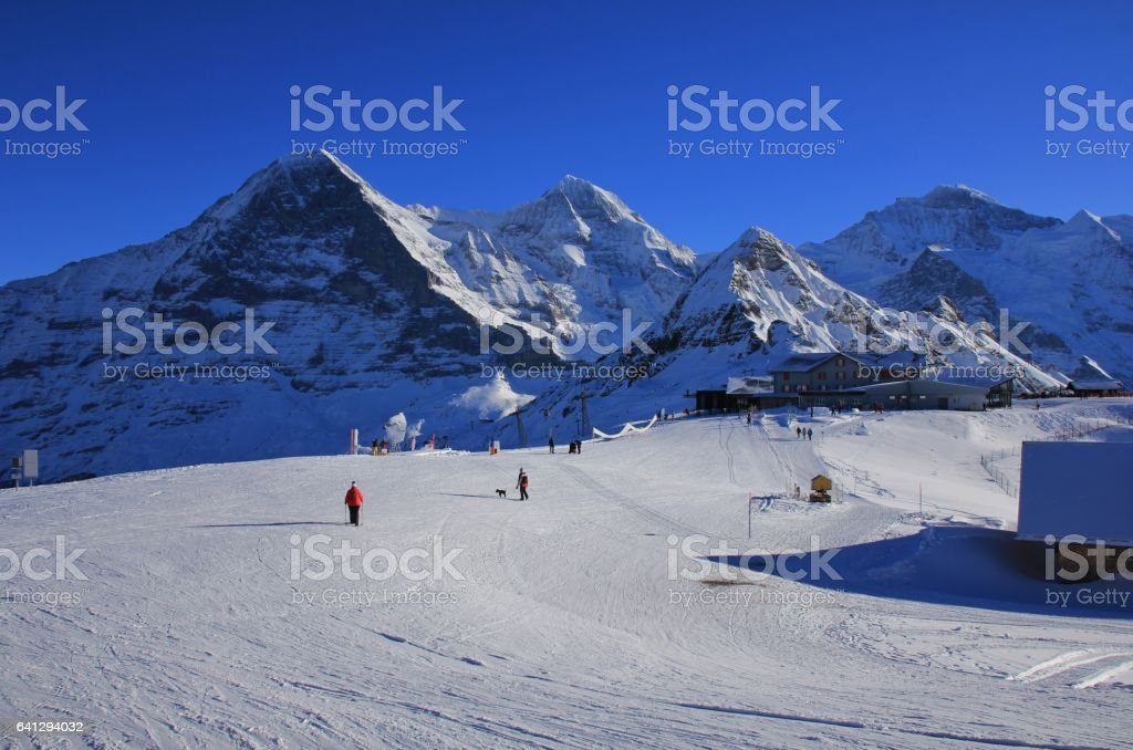 Ski slope and snow covered mountains Eiger, Monch, Lauberhorn and Jungfrau stock photo