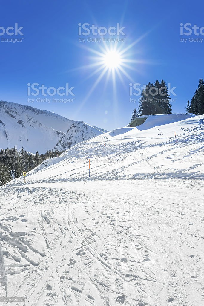 Ski slope in a beuatiful sunny weather in Swiss Alps stock photo