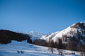 Ski slope in mountains with clear sky and sunshine