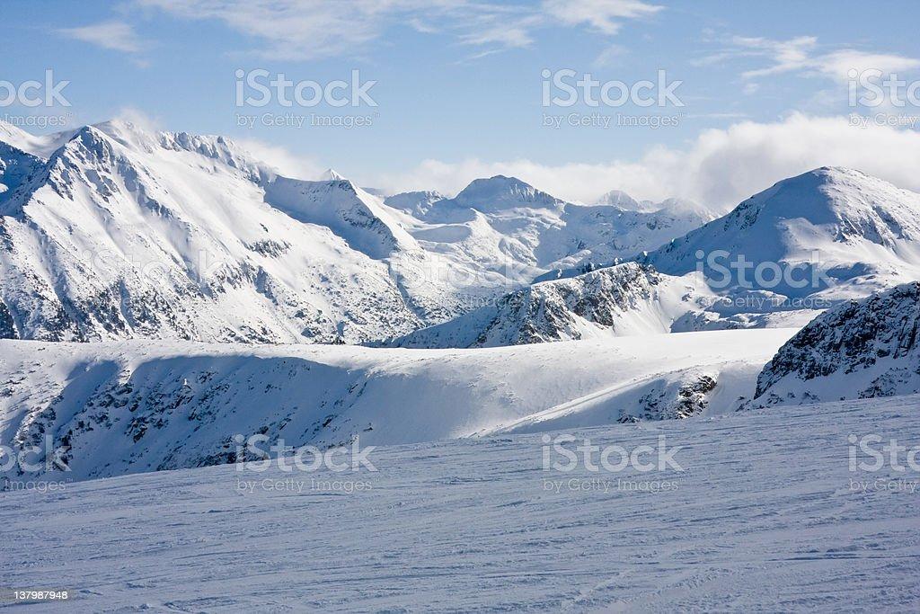 Ski slope in winter mountains royalty-free stock photo