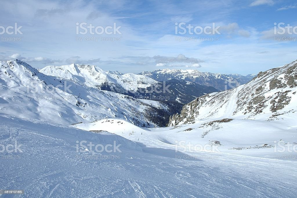 Ski slope, peaks and valley in Alps in winter stock photo