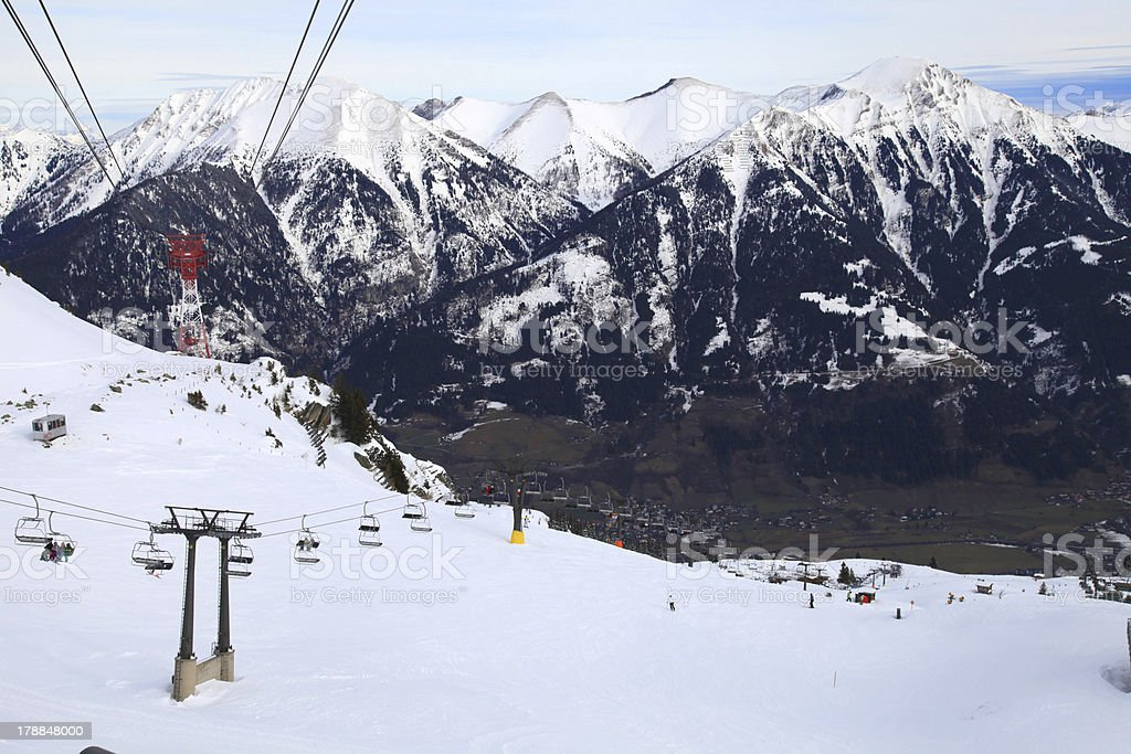 Ski slopes with lifts and skiers royalty-free stock photo