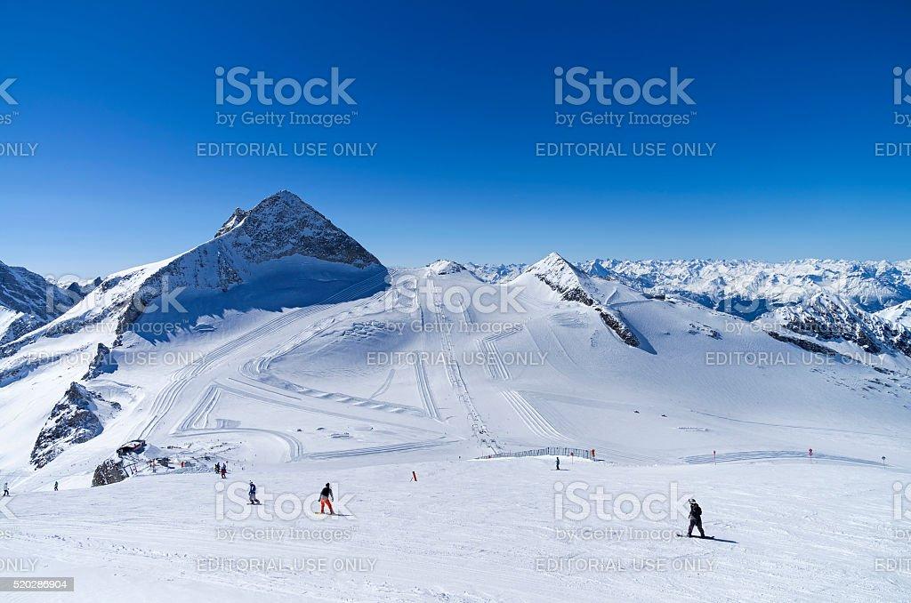 Ski slops on  top of the glacier in  Alps. stock photo