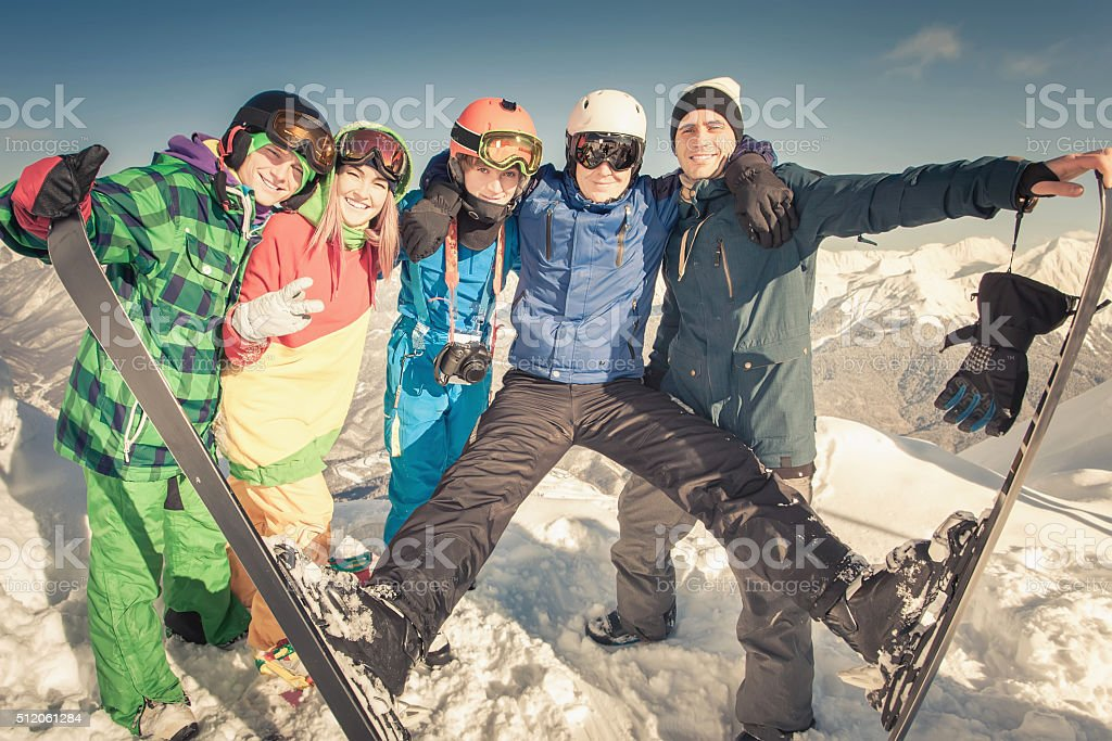 Ski. Sport woman and man in snowy mountains stock photo