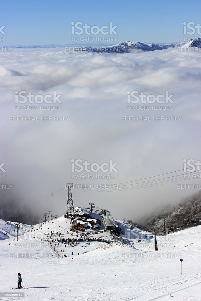Ski station at CERRO CATEDRAL above the clouds (Vertical composition) royalty-free stock photo