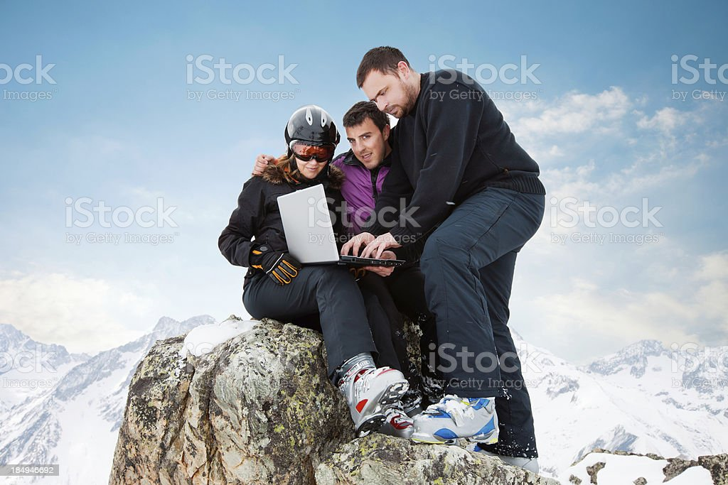 Ski team  with a laptop on the top stock photo