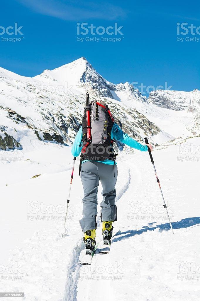 Ski touring in sunny weather. stock photo