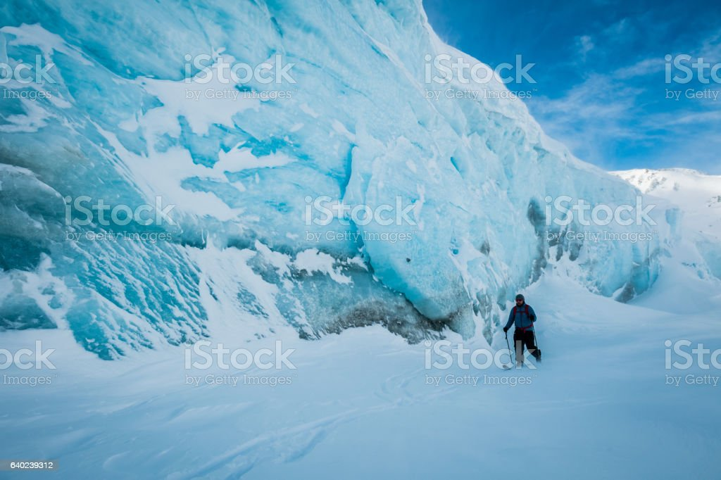 Ski touring past an ancient glacier stock photo