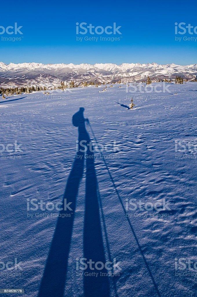 Ski Touring Shadow High in Mountains Winter stock photo