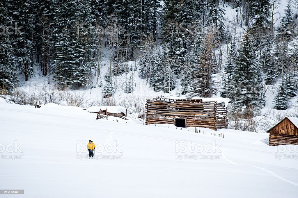 Ski Touring with Old Cabins stock photo