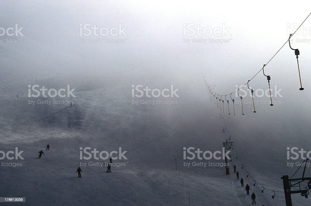Ski tow and skiers' silhouettes royalty-free stock photo