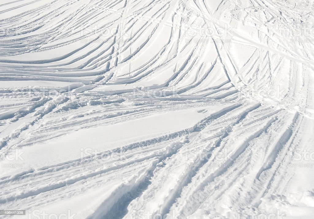 Ski tracks in the snow stock photo