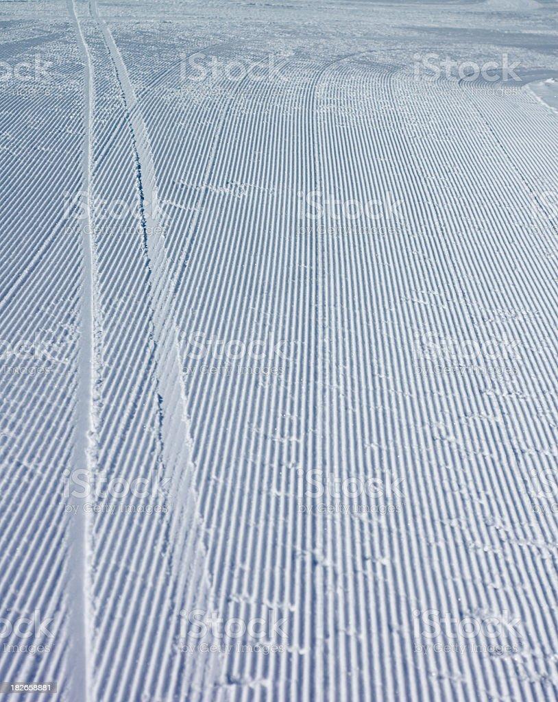 Ski tracks on fresh corduroy royalty-free stock photo