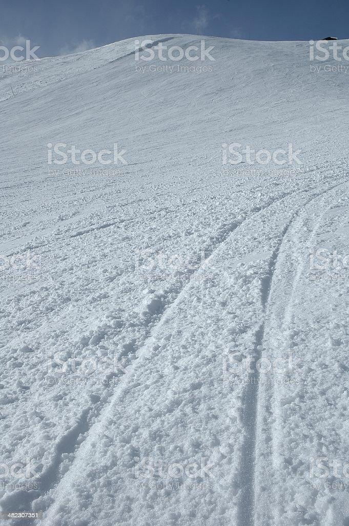 Ski tracks on slope stock photo