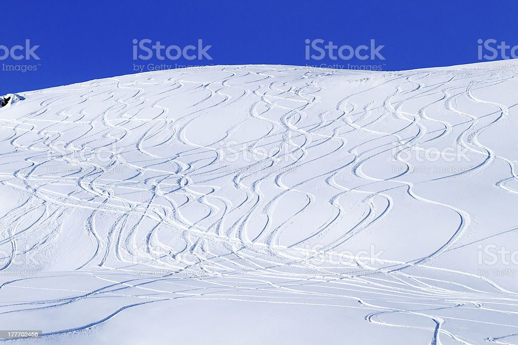 Ski Tracks on Snowcovered Mountain Side royalty-free stock photo