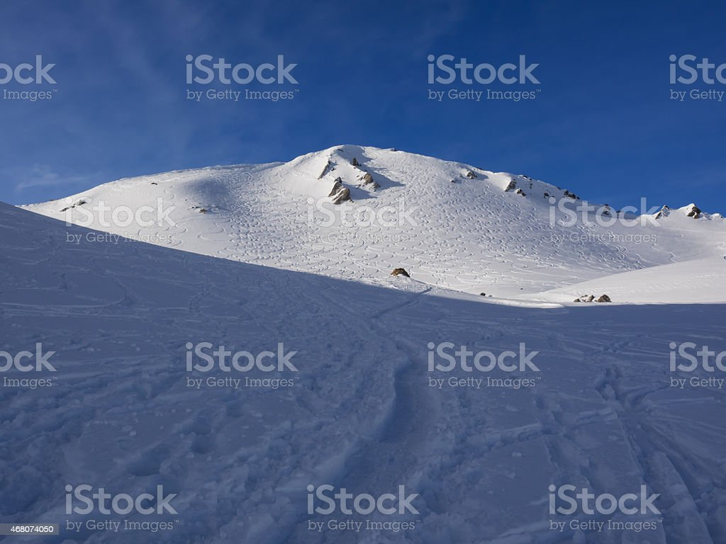 Ski tracks on the mountain (Wissmilen/Flumserberg) stock photo