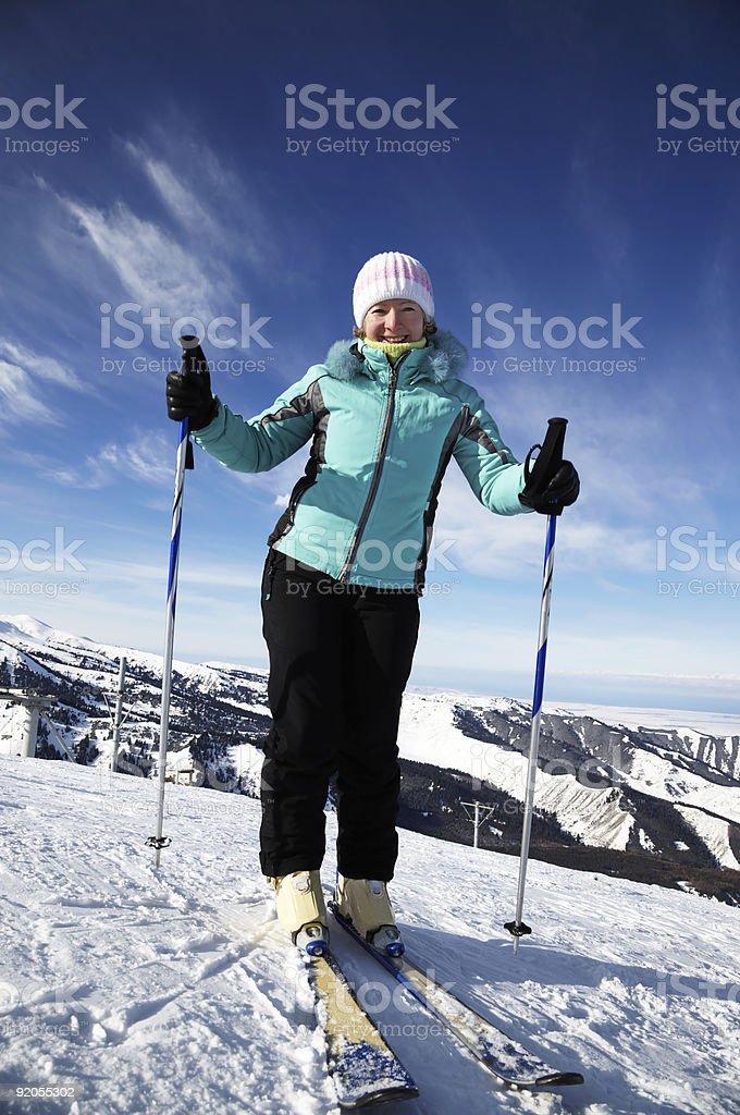 Ski woman on mountain resort royalty-free stock photo