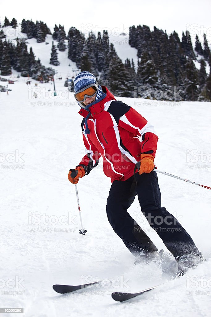 Ski woman turn on slope royalty-free stock photo