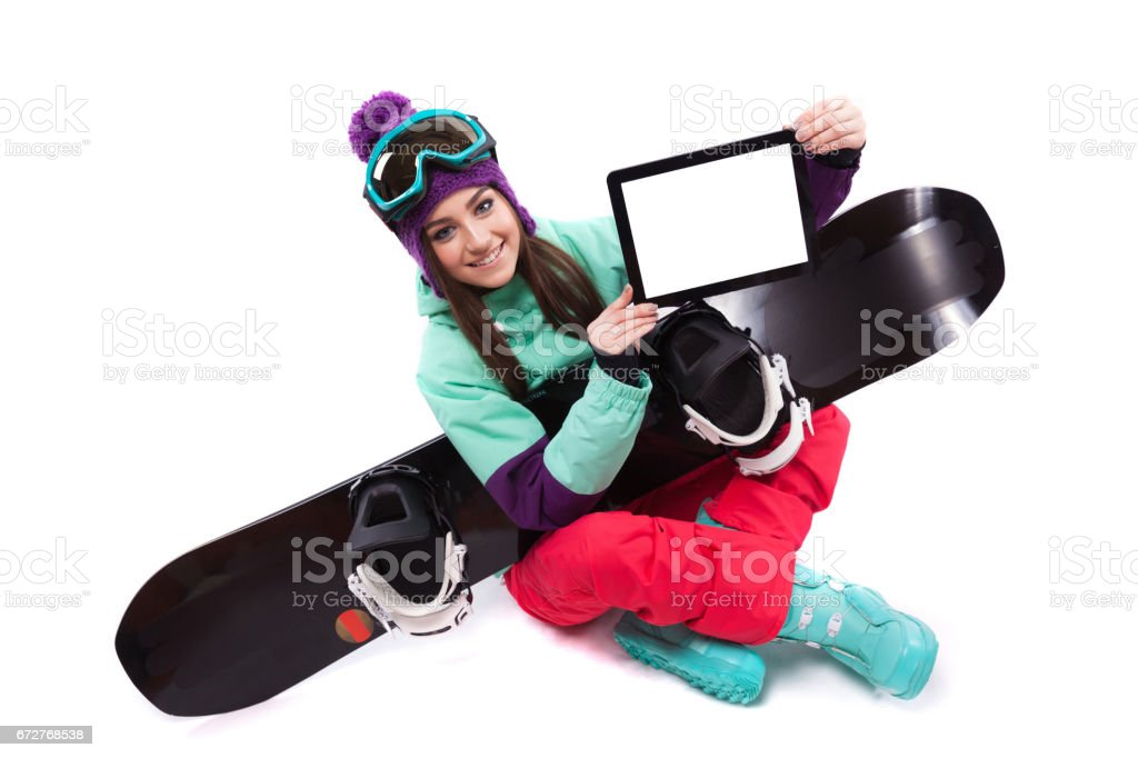 ski woman with snowboard showing tablet stock photo