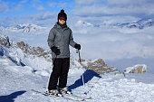 Ski Young women snow skiers enjoying resting Winter landscape