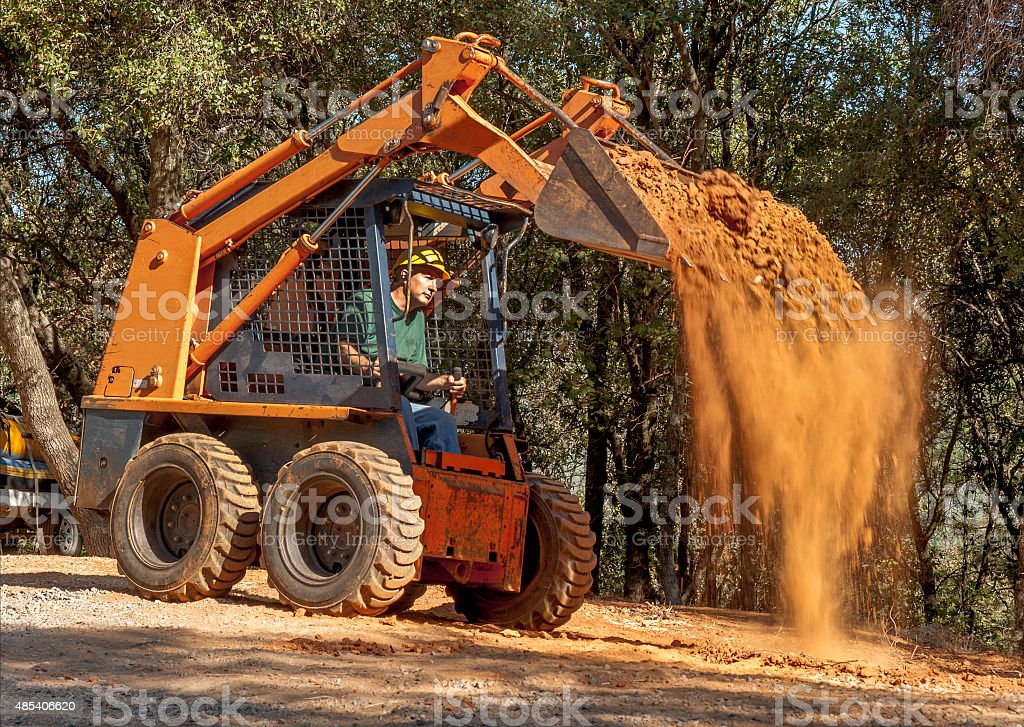 Skid Loader with Operator stock photo