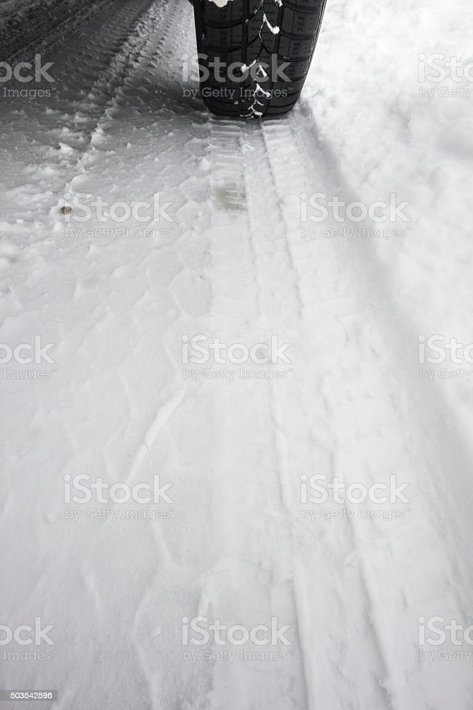 Skid mark on a snowy road stock photo