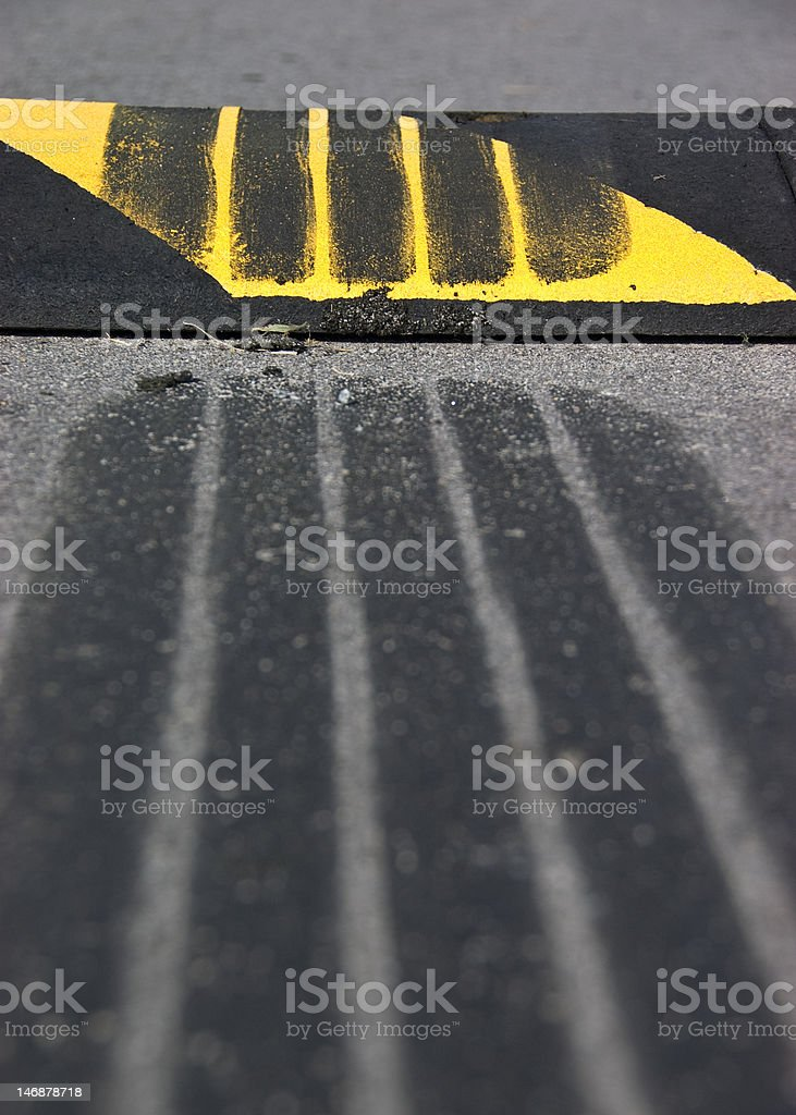 Skid Mark over a Speed Bump stock photo