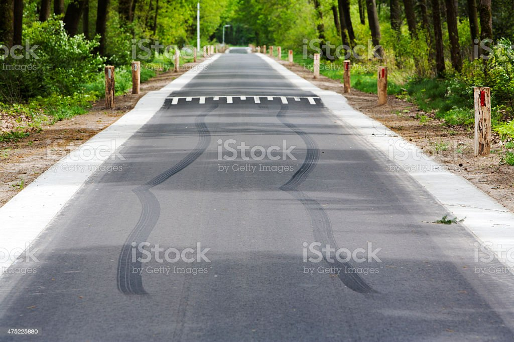 Skid marks in front of speed bump stock photo