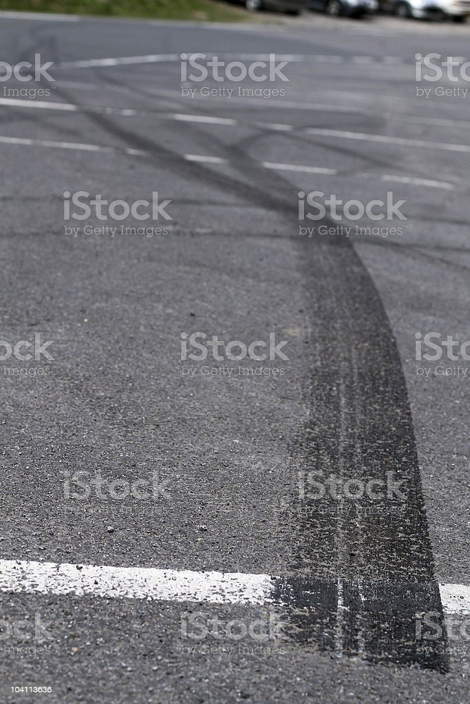 Skid marks left by bored teen drivers stock photo