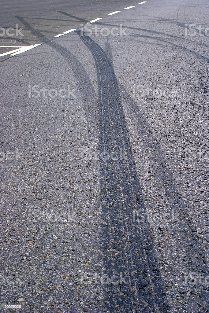 Skid marks left by teen drivers at play royalty-free stock photo