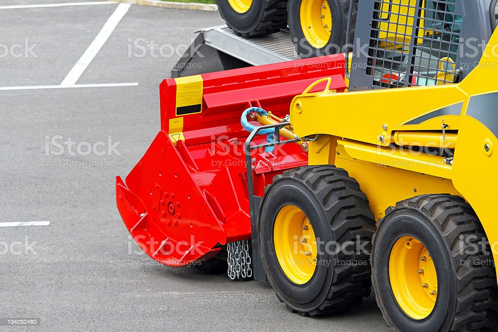Skid steer attachment royalty-free stock photo