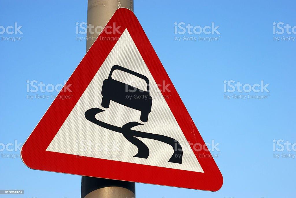 Skidding car roadsign stock photo