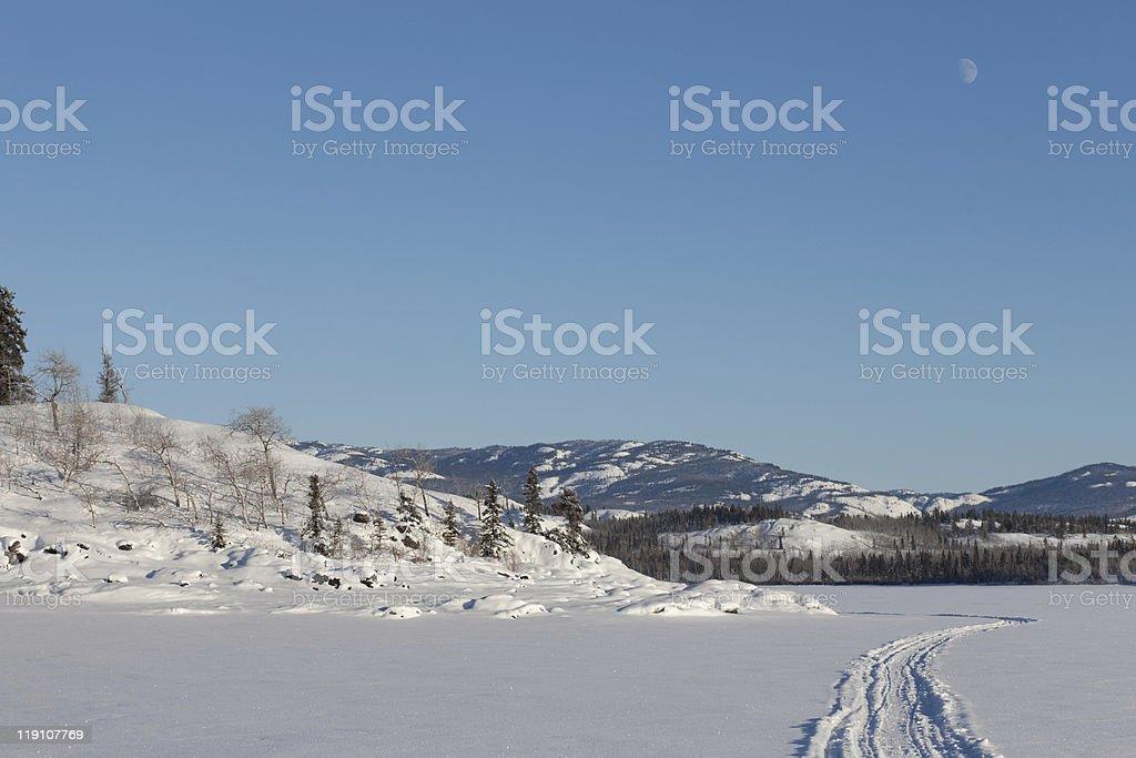 Skidoo track on frozen lake royalty-free stock photo