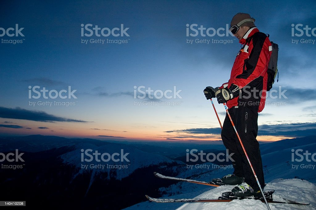Skier at the sunset royalty-free stock photo
