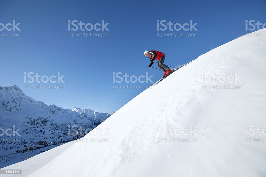 Skier at the top of a Mountain royalty-free stock photo