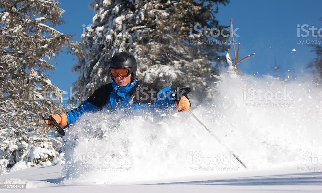 Skier  Carving in Fresh Powder Snow stock photo