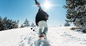 Skier climbing the ski slope
