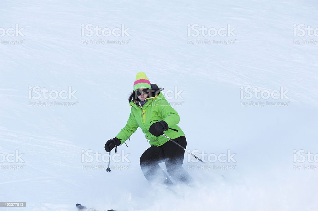 Skier coming down the slope royalty-free stock photo