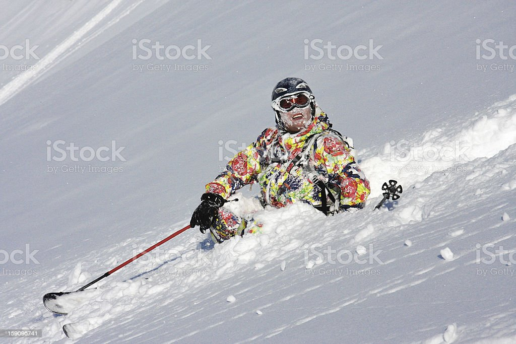 Skier crashes in the snow stock photo