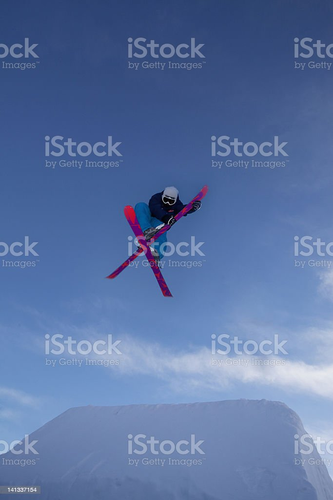 Skier crossing skis in the air stock photo