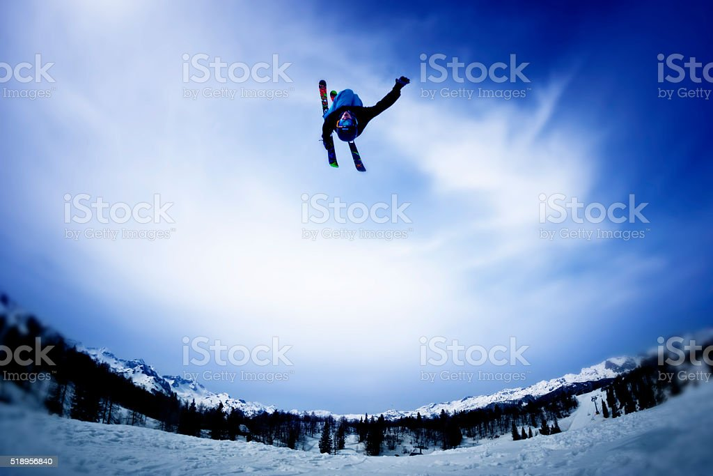 Skier doing backflip and waving stock photo