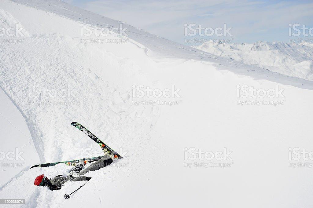 Skier doing flip on snowy slope stock photo