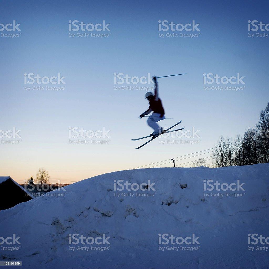Skier Doing Jump at Sunset stock photo