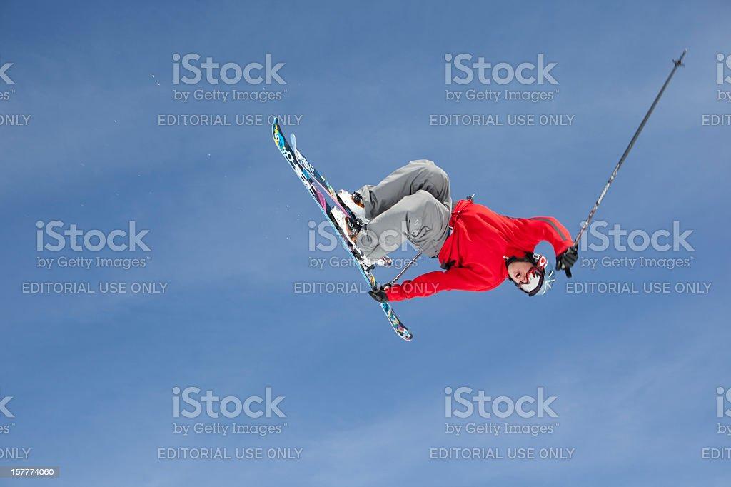 Skier doing tricks in a terrain park stock photo
