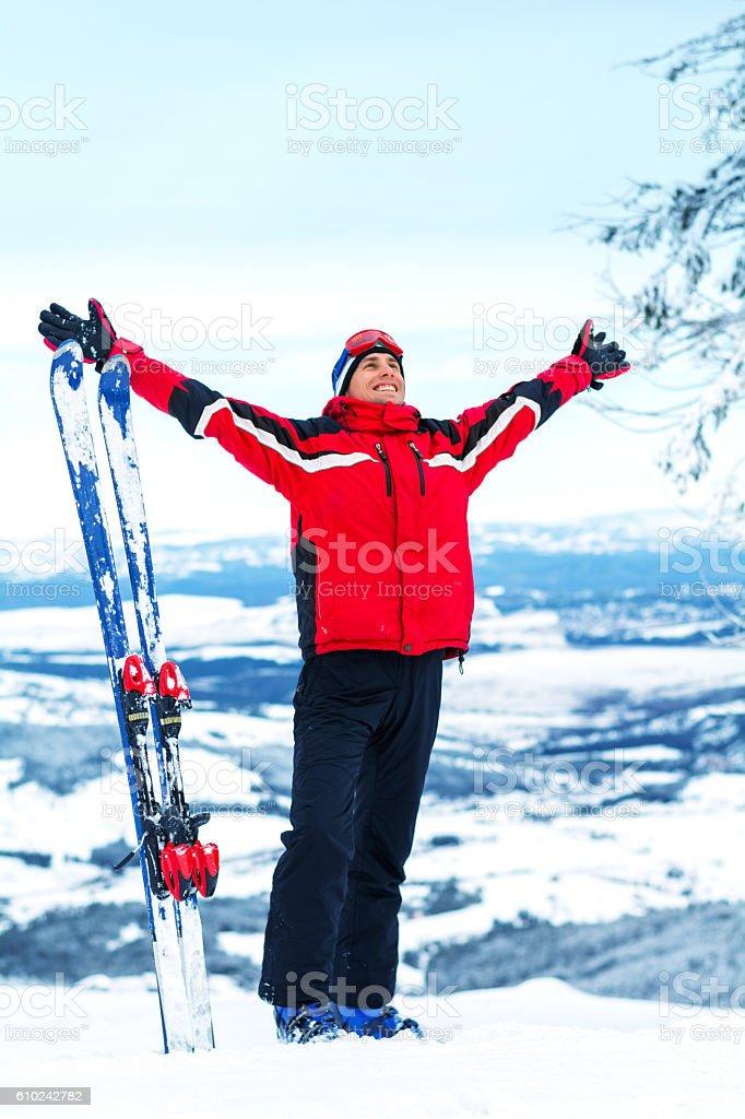 Skier enjoying the mountains stock photo