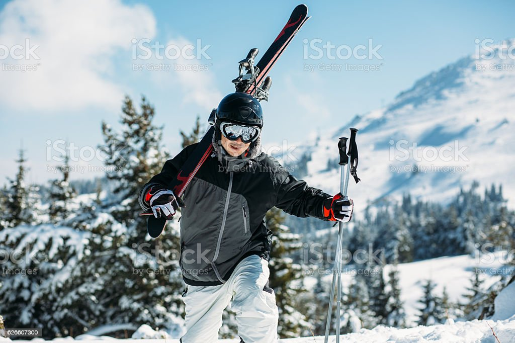Skier hiking in the mountain stock photo