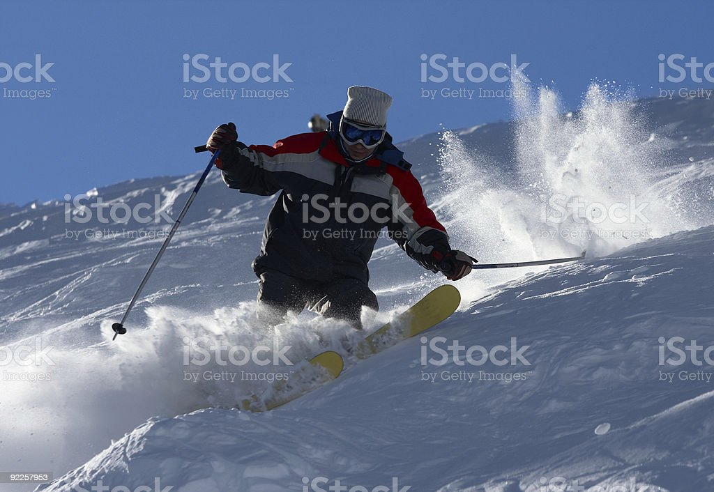 skier in clouds of snow powder stock photo